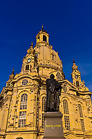 Statue of Martin Luther in the Neumarkt area with the Frauenkirche (church) in background, Dresden, Saxony, Germany