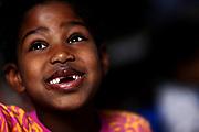 Birtukan Mueller, 7, shows her two missing front teeth on Saturday December 19, 2009.<br /> <br /> (William DeShazer/Chicago Tribune)