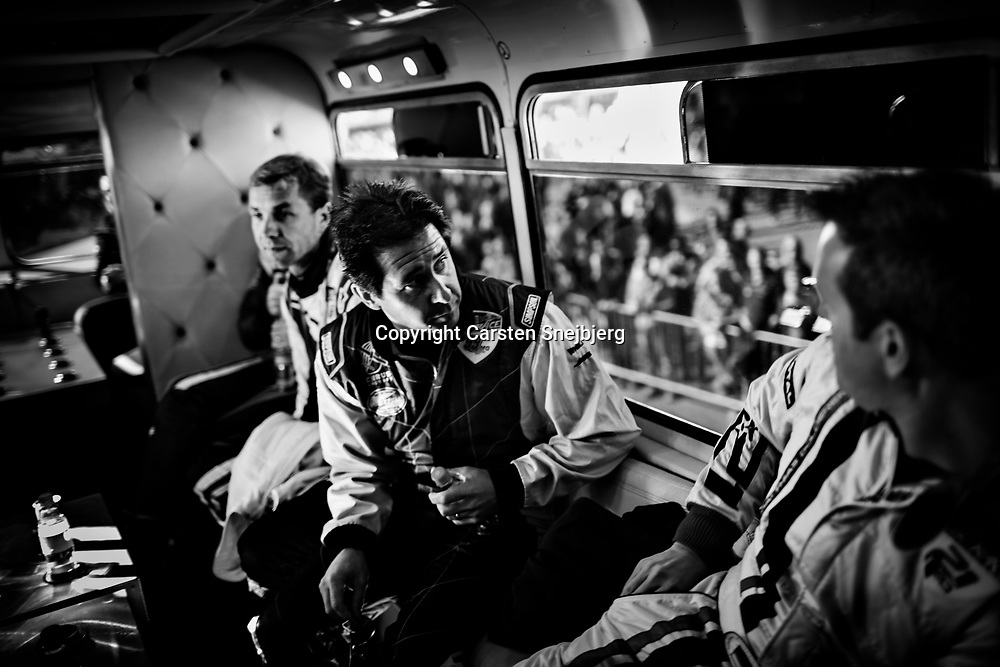 Pilots in a private moment in the bus, where they enjoy great support from fans in a sold out arena.