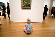 a little boy studying Joseph Roulin a by Vincent Van Gogh painting Museum of Modern Art New York