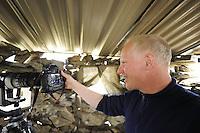 Staffan Widstrands with cameras in hide for bustards, La Serena, Extremadura, Spain