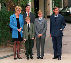 Prince William poses with the Prince and Princess of Wales, Prince Harry and housemaster Dr. Andrew Gailey at he starts at Eton College on September 16, 1995 in Windsor, England.