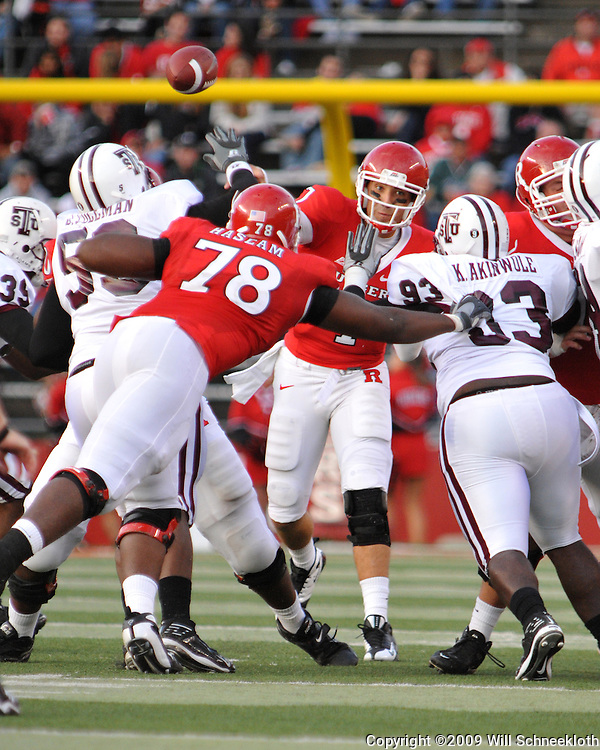 Oct 10, 2009; Piscataway, NJ, USA; Rutgers quarterback Tom Savage (7) throws the ball over battling linemen during second half NCAA college football action in Rutgers' 42-0 victory over Texas Southern at Rutgers Stadium.