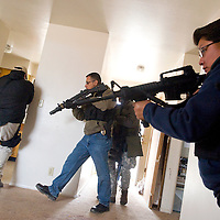 012513       Brian Leddy<br /> Gallup Police Department detectives and narcotics officers practice search and sweep techniques during a training exercise Friday.
