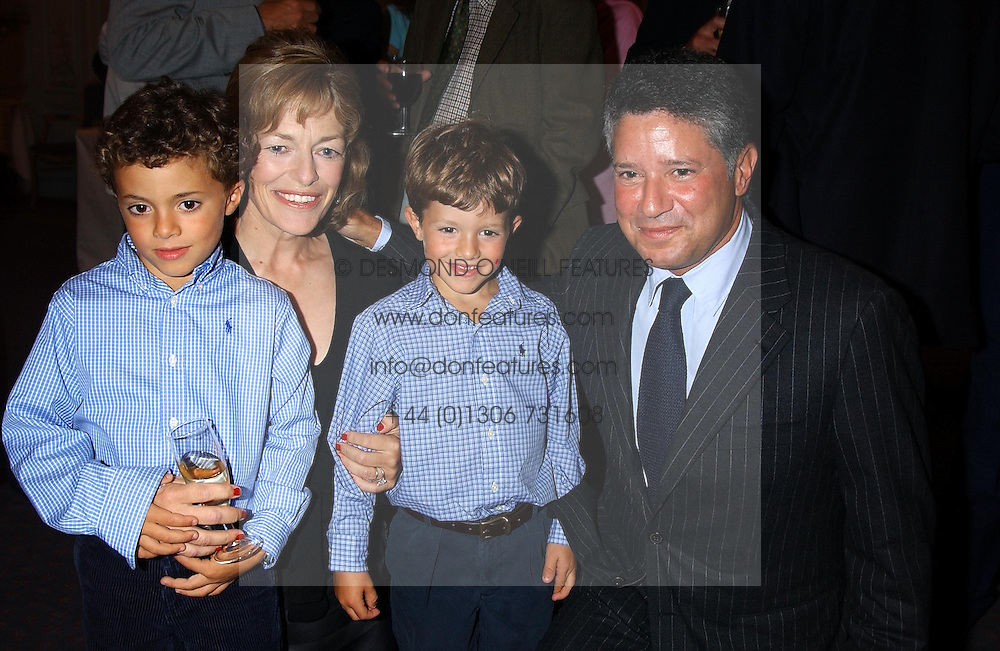 FLORA FRASER and her husband PETER SOROS with their sons SIMON & TOMMY at a party to celebrate the publication of 'Princesses' the six daughters of George 111 by Flora Fraser held at the Saville Club, Brook Street, London W1 on 14th September 2004.<br /><br />NON EXCLUSIVE - WORLD RIGHTS