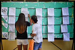 May 12, 2019 - Mandaluyong, National Capital Region, Philippines - Many Filipinos are exercising their right to vote for the country's future...Voters are looking which voting precinct that their names are enlisted. (Credit Image: © George Buid/ZUMA Wire)