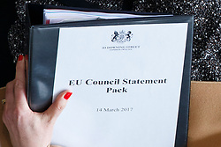"© Licensed to London News Pictures. 14/03/2017. London, UK. Prime Minister THERESA MAY holds a ""EU Council Statement Pack"" as she leaves Downing Street to go to Parliament after a cabinet meeting in Downing Street, London on Tuesday, 14 March 2017. Photo credit: Tolga Akmen/LNP"