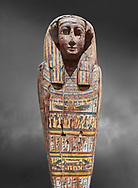 Ancient Egyptian wooden sarcophagus - the tomb of Tagiaset, Iuefdi & Harwa circa 25nd Dynasty (7th cent BC.) Thebes. Egyptian Museum, Turin. Grey background.<br /> <br /> Possibly the sarcophagus of the daughter of Tagiaset. There is a depiction of a wesekh collar around the neck. .<br /> <br /> If you prefer to buy from our ALAMY PHOTO LIBRARY  Collection visit : https://www.alamy.com/portfolio/paul-williams-funkystock/ancient-egyptian-art-artefacts.html  . Type -   Turin   - into the LOWER SEARCH WITHIN GALLERY box. Refine search by adding background colour, subject etc<br /> <br /> Visit our ANCIENT WORLD PHOTO COLLECTIONS for more photos to download or buy as wall art prints https://funkystock.photoshelter.com/gallery-collection/Ancient-World-Art-Antiquities-Historic-Sites-Pictures-Images-of/C00006u26yqSkDOM