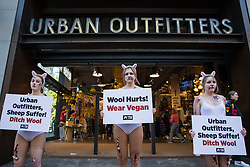 PETA supporters dressed as bloodied sheep protest outside a branch of Urban Outfitters in Oxford Street to call for an end to wool sales on 21st October 2021 in London, United Kingdom. The protest forms part of an international PETA campaign to urge Urban Outfitters Inc brands including Anthropologie and Free People to stop selling materials cruelly taken from animals.
