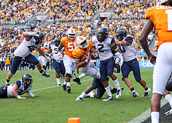 Sep 1, 2018; Charlotte, NC, USA; Tennessee Volunteers quarterback Jarrett Guarantano (2) is hit by West Virginia Mountaineers safety Kenny Robinson (2) inside the five yard line during the first quarter at Bank of America Stadium. Mandatory Credit: Ben Queen-USA TODAY Sports