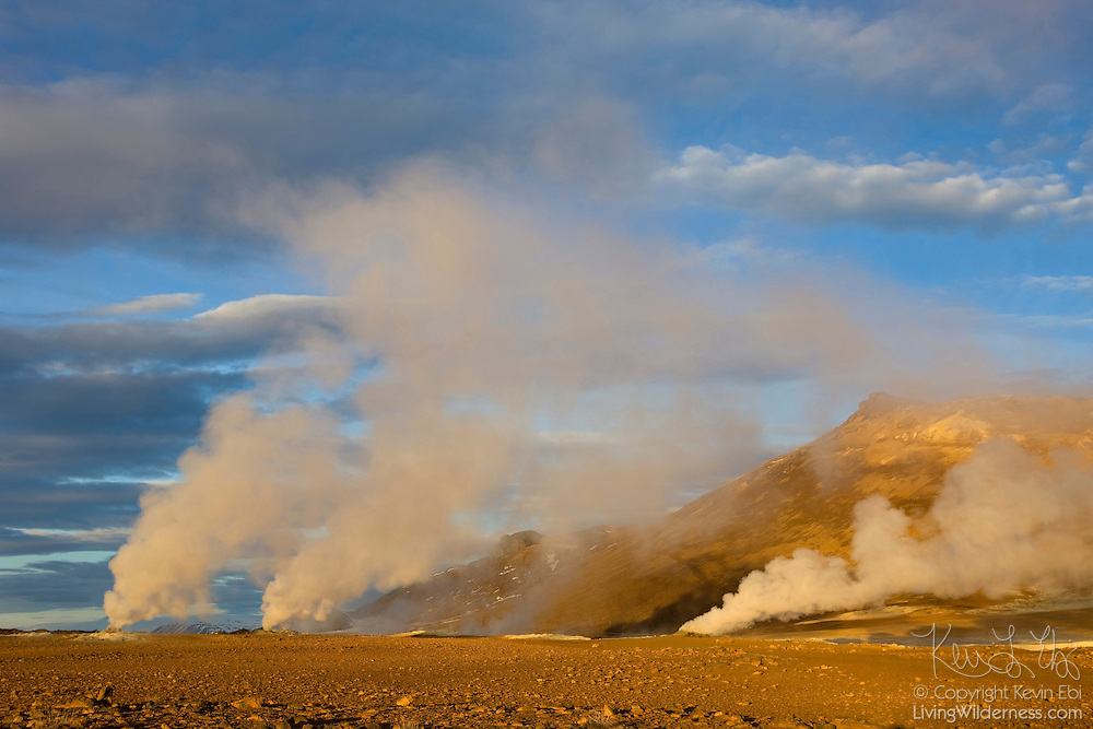 Several fumeroles shoot steam high into the sky at sunrise at Hverir, an especially active geothermal field in northern Iceland.