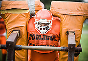 A Coolidge High School offensive lineman pushes a sled during a strength drill during practice Wednesday September 9, 2009 at Coolidge High School in NW Washington DC.