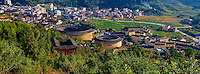 "Chine, Province du Fujian, village de Zhencheng Lou, maison forteresse en terre et en bois où logent les membres d'une meme famille de l'ethnie Hakka, inscrit au patrimoine mondial de l'Unesco // China, Fujian province, Zhencheng Lou village, Tulou mud house. well known as the Hakka Tulou region, in Fujian. In 2008, UNESCO granted the Tulou ""Apartments"" World Heritage Status, siting the buildings as exceptional examples of a building tradition and function exemplifying a particular type of communal living and defensive organization. The Fujian Tulou is ""the most extraordinary type of Chinese rural dwellings"" of the Hakka minority group and other people in the mountainous areas in southwestern Fujian."