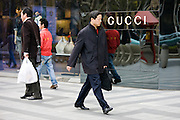 Man walks past Gucci shop on Nanjing Road, central Shanghai, China