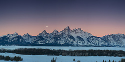 """A setting moon at sunrise in Grand Teton National Park. <br /> <br />  This panorama is a large file and can be printed at 36X18 at 300 DPI.<br /> <br /> For production prints or stock photos click the Purchase Print/License Photo Button in upper Right; for Fine Art """"Custom Prints"""" contact Daryl - 208-709-3250 or dh@greater-yellowstone.com"""