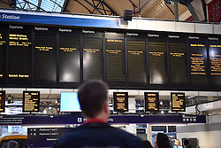 © Licensed to London News Pictures. 14/12/2016. London, UK.  Empty departure boards at Victoria Station in London on 14 December 2016, as hundreds of thousands of rail passengers face a second day of a 3 day all-out strike in an escalating dispute over the role of conductors between Southern Rail and the RMT Union. Photo credit: Ben Cawthra/LNP