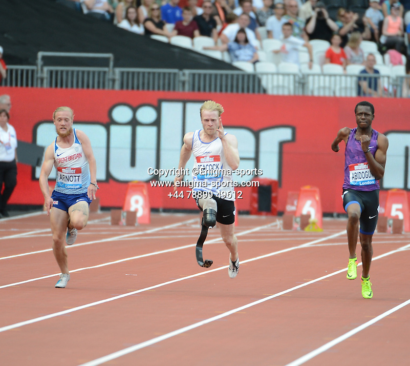 Jonny Peacock competes in the men's T44-64 100m during the IAAF Diamond League at the Queen Elizabeth Olympic Park London, England on 20 July 2019.