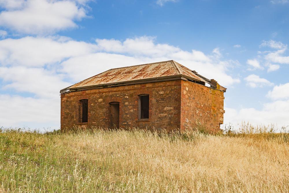 dilapidated old brick farm house in a field near Pallamana, South Australia, Australia <br /> <br /> Editions:- Open Edition Print / Stock Image