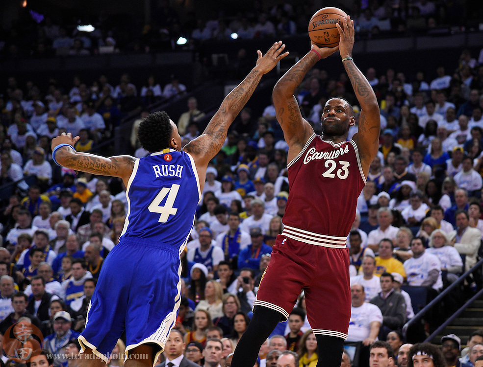 Dec 25, 2015; Oakland, CA, USA; Cleveland Cavaliers forward LeBron James (23) shoots over Golden State Warriors forward Brandon Rush (4) in the first half of a NBA basketball game on Christmas at Oracle Arena.