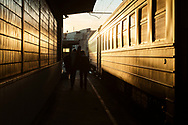 Riga, Latvia - March 15, 2020: Passengers disembark a train at Riga Central Station, returning to the city after a day in Jūrmala.