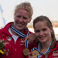 Laurence Vincent-lapointe (L) and Mallorie Nicholson (R) from Canada celebrate their victory in the C2 Women 500m Final of the 2011 ICF World Canoe Sprint Championships held in Szeged, Hungary on August 20, 2011. ATTILA VOLGYI