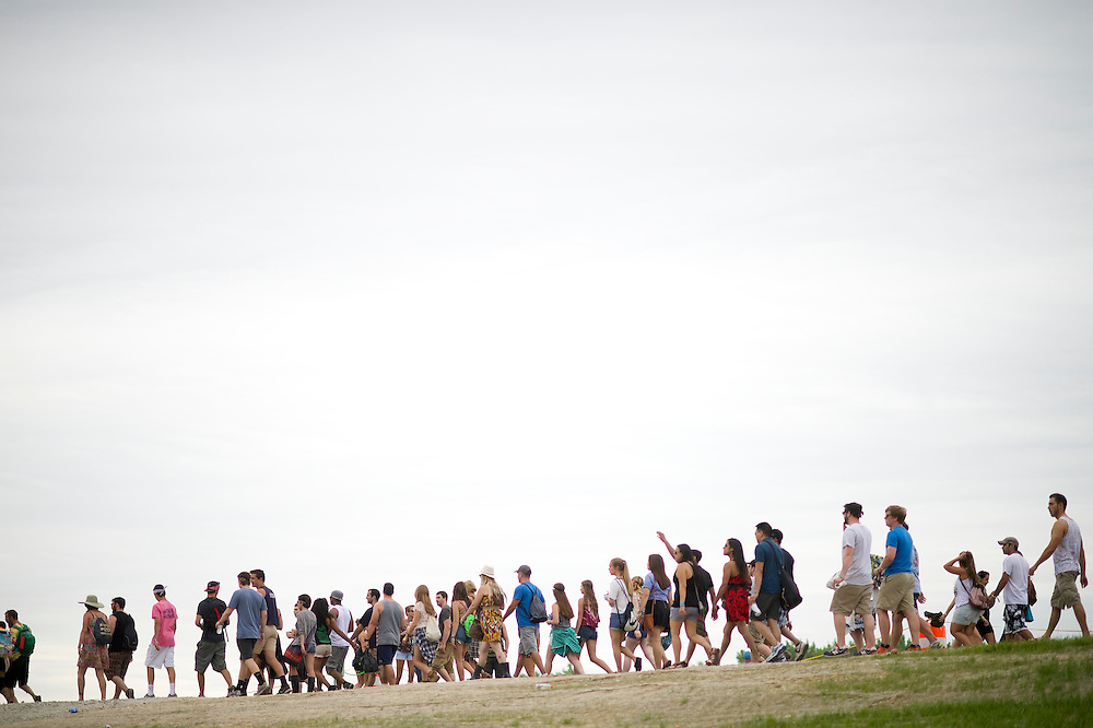 Concert goers walk towards the main entrance during the Firefly Music Festival in Dover, DE on June 21, 2014.  The four day festival is set at a 105 acre grounds at the Dover International Speedway and many well known bands perform.