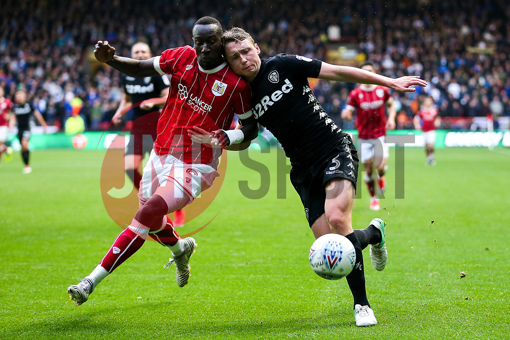 Famara Diedhiou of Bristol City and Cameron Borthwick-Jackson of Leeds United - Rogan/JMP - 21/10/2017 - Ashton Gate Stadium - Bristol, England - Bristol City v Leeds United - Sky Bet Championship.
