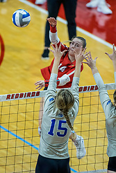 BLOOMINGTON, IL - October 23: Sarah Kushner  powers a hit past Kacie Rewerts during a college Women's volleyball match between the ISU Redbirds and the Drake Buldogs on October 23 2021 at Illinois State University in Normal, IL. (Photo by Alan Look)