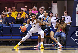 Dec 1, 2019; Morgantown, WV, USA; West Virginia Mountaineers forward Gabe Osabuohien (3) dribbles the ball while defended by Rhode Island Rams forward Mekhi Long (15) during the first half at WVU Coliseum. Mandatory Credit: Ben Queen-USA TODAY Sports