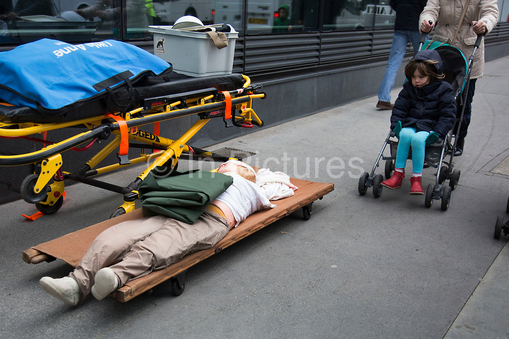 Fake body on s stretcher. The Lord Mayor's Show, one of the longest-established annual events, dating back to the 16th century. Held within the City of London, UK.