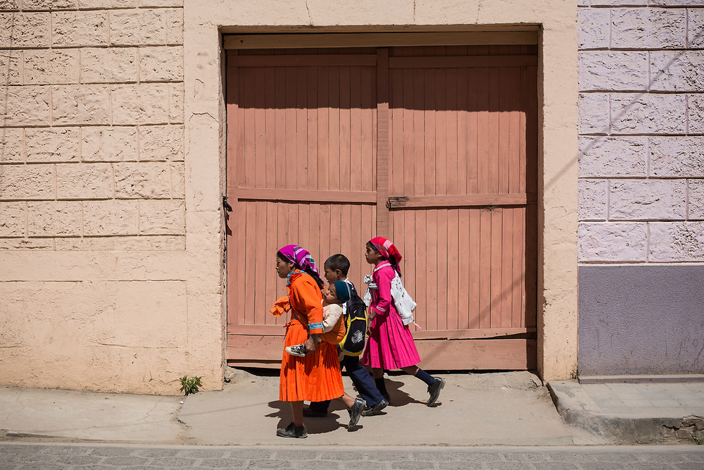 A street scene in Intibucá, women wearing typical Lenca dresses walk along the street. Berta Cáceres campaigned and organised communities in Intibucá and other areas of Honduras to defend indigenous rights and territories before her assassination.
