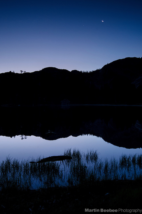 Crescent moon at dawn over Bull Run Lake, Carson-Iceberg Wilderness, Stanislaus National Forest, California