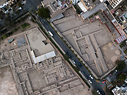 """In this Oct. 6 2017 photo, the pre-Columbian archeological site Pucllana is divided by Independence Street in the Miraflores district of Lima, Peru. Pucllana is just one of thousands of historic sites, or """"huacas,"""" that are being crowded out or destroyed as roads, schools, residential neighborhoods and stadiums are built to meet the population's growing demands."""