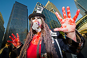 members of the public dressed as Zombie bankers stage a flashmob outside West entrance Canary Wharf tube station where they will 'feed' on doctors, nurses, teachers and other public sector workers.