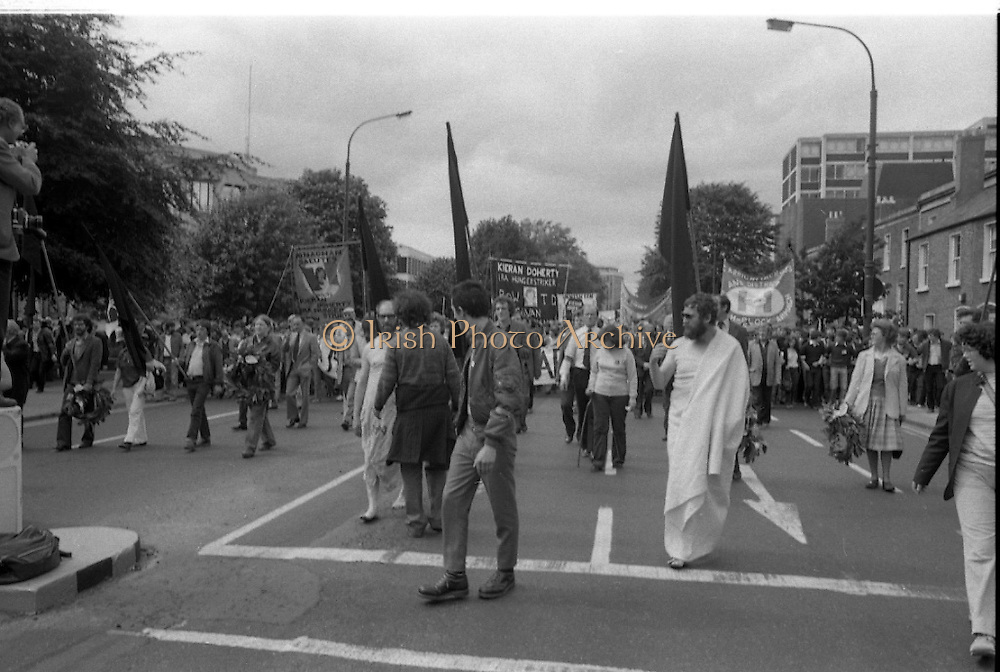 """H-Block Protest To British Embassy.  (N86)..1981..18.07.1981..07.18.1981..18th July 1981..A protest march to demonstrate against the H-Blocks in Northern Ireland was held today in Dublin. After the death of several hunger strikers in the H-Blocks feelings were running very high. The protest march was to proceed to the British Embassy in Ballsbridge...Protestors wearing """"The Blanket"""" and Wreath Carriers lead this section of the march."""