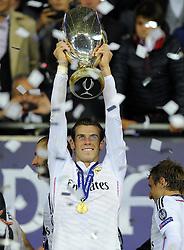 Real Madrid's Gareth Bale lifts the Uefa Super Cup - Photo mandatory by-line: Joe Meredith/JMP - Mobile: 07966 386802 12/08/2014 - SPORT - FOOTBALL - Cardiff - Cardiff City Stadium - Real Madrid v Sevilla - UEFA Super Cup