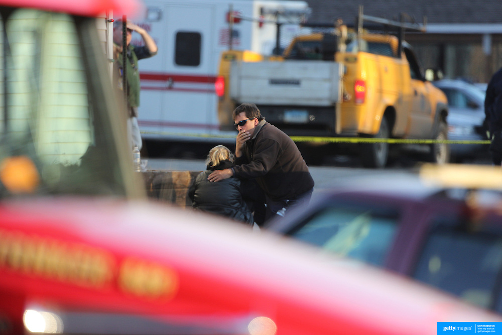 Unidentified people, believed to be parents, distraught at the fire station in Sandy hook after today's shootings at Sandy Hook Elementary School, Newtown, Connecticut, USA. 14th December 2012. Photo Tim Clayton