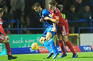 Jordan Williams is challenged by Callum Johnson during the EFL Sky Bet League 1 match between Rochdale and Accrington Stanley at Spotland, Rochdale, England on 24 November 2018.