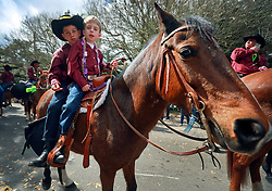 02 March 2014. New Orleans, Louisiana.<br /> Mardi Gras. kids on a horse at the Krewe of Thoth parade in Uptown New Orleans.<br /> Photo; Charlie Varley/varleypix.com