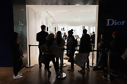 © Licensed to London News Pictures. 26/12/2016. Customers queuing for Dior shoes in Selfridges store in Oxford Street for the start of the stores Boxing Day sales. London, UK. Photo credit: Ray Tang/LNP