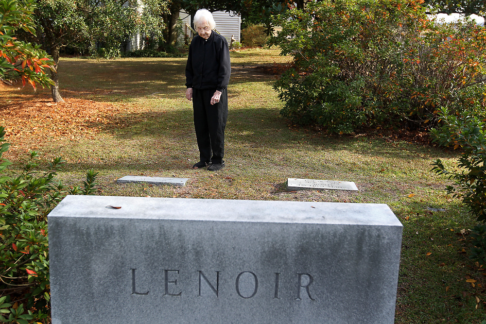 """Carrie LeNoir looks at her grave plot where she will be buried next to her husband at Episcopal Church of the Ascension. Mrs. LeNoir had her name and date of birth  carved into her headstone. """"It's the way she wanted it. She didn't want us to be under financial pressure when she passes,"""" said her daughter Beverly LeNoir."""