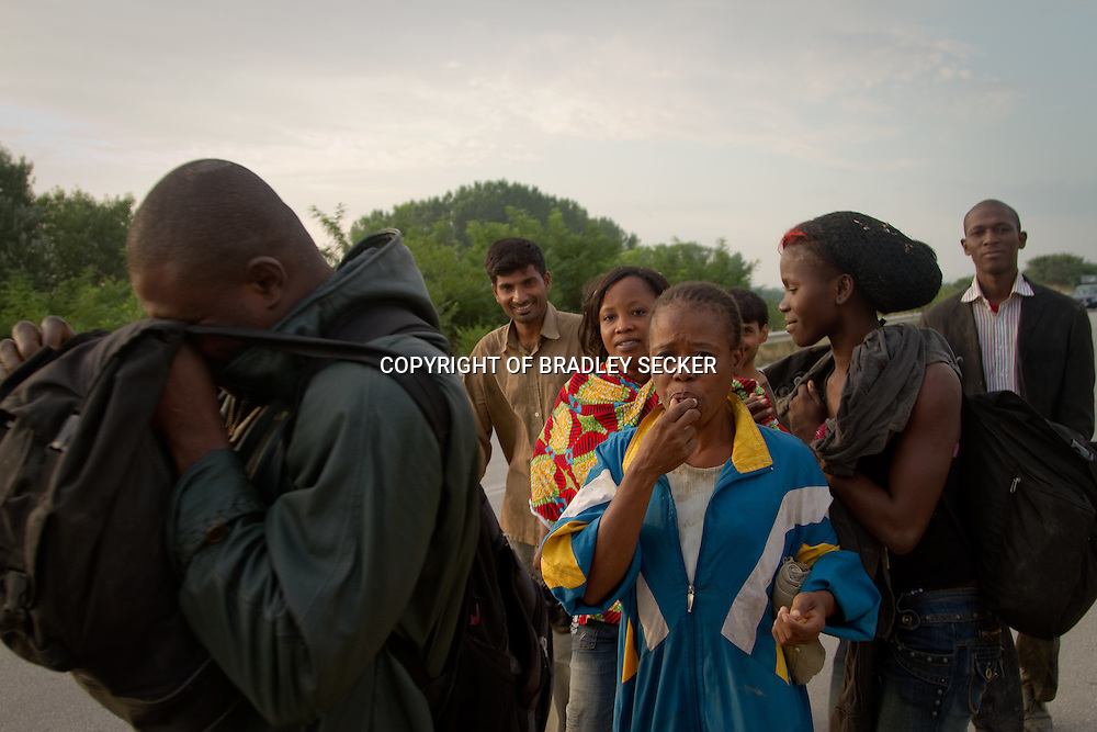 Migrants that have just swam into Greece walk along a road looking for a police station to hand themselves in. Soufli, Evros, Greece. July 2011<br /> <br /> This image is one of three entered into the 2011 Accademia Apulia photo award
