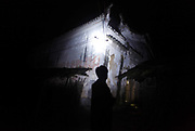 A man uses a flashlight to see his way through the village of Duntang, in Daoxian County, Hunan Province, China, on 03 June, 2010. Duntang was connected to the main electricity grid and began to receive regular supply of electricity only since the beginning of 2009.