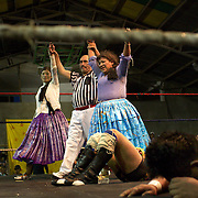 Cholita wrestlers Yolanda La Amorosa (left) and her tag team mate Carman Rosa celebrate victory over their male counterparts during the 'Titans of the Ring' wrestling group's Sunday performance at El Alto's Multifunctional Centre. Bolivia. The wrestling group includes the fighting Cholitas, a group of Indigenous Female Lucha Libra wrestlers who fight the men as well as each other for just a few dollars appearance money. El Alto, Bolivia, 11th April 2010. Photo Tim Clayton