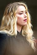 """American actress and model Amber Heard gives a statement in front of the Royal Courts of Justice in central London on Tuesday, July 28, 2020.<br /> An article in the Sun describing Johnny Depp as a """"wife-beater"""" was """"one-sided"""" and """"not researched at all"""", the actor's lawyer told the High Court. In closing submissions for Mr Depp, David Sherborne said the paper acted as """"both judge and jury"""". Mr Depp is suing the newspaper's publisher and editor for libel, saying the allegation is """"completely untrue"""". (VXP Photo/ Vudi Xhymshiti)"""