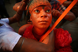 April 13, 2018 - Dhaka, Bangladesh - Hindu devotees dance as they take part in a festival called Lal Kach (Red Glass) during the last day of the Bangla month in Munshigonj, Dhaka, Bangladesh, on 13 April 2018.The Lal Kach festival is well known for the local community for more than hundred years. The Hindu youth and men paint themselves with red color and attend a procession holding swords as they show power against evil and welcome the Bengali New Year 1425 on 14 April 2018  (Credit Image: © Mushfiqul Alam/NurPhoto via ZUMA Press)