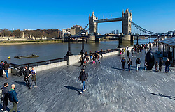 © Licensed to London News Pictures. 04/04/2021. London, UK. People enjoy warm and sunny weather on Easter Sunday on Riverside with the view of Tower Bridge under clear blue skies. Photo credit: Dinendra Haria/LNP