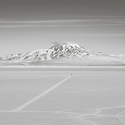 View out toward Mt. Discovery. The tracks on the Ross Ice Shelf leads to SIMPLE camp, where the team was testing Artemis,  an underwater/under ice robot prototype destined for Jupiter's moon Europa