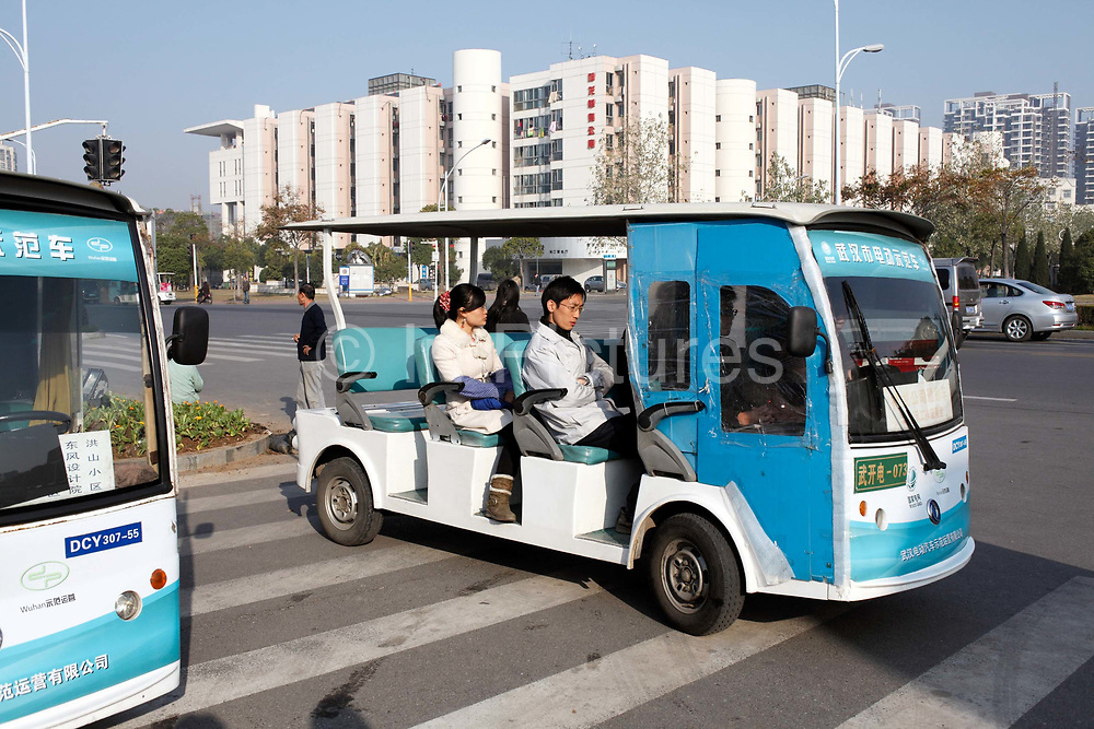 Workers at the Dongfeng Citroen factory commute to work by small electric shuttles in Wuhan, Hubei Province, China on 24 November 2009.  Automakers from across the world are increasingly focusing their efforts on China, the largest auto market in the world and the only major market with prospects of high growth rate.