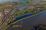 Nederland, Gelderland, Brummen, 20-01-2011; Bandijk bij hoogwater, N48/N348 naar Zutphen.High water in the river IJssel, flood-wal or winter dike protecting the land and the motorway to Zutphen against it..luchtfoto (toeslag), aerial photo (additional fee required).copyright foto/photo Siebe Swart